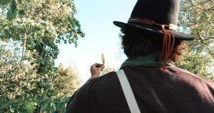 Adam Birchweaver examining a leaf in nature