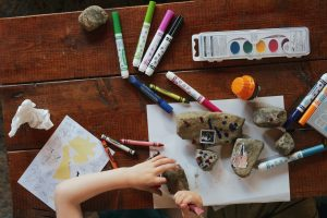 A child painting rocks
